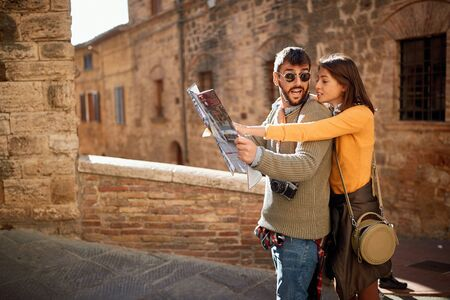 Young happy lovers couple visiting Italy as tourists
