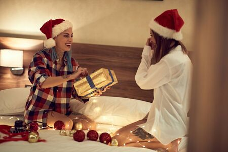 Smiling Couple exchanging Christmas presents.