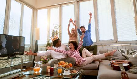 Cheerful people having fun at home