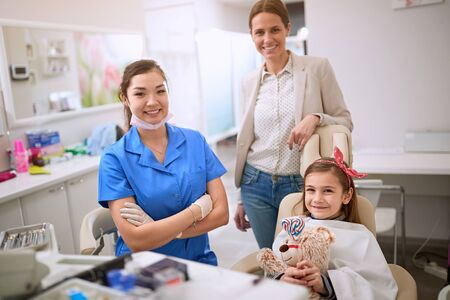 Smiling child and her mom at dentist