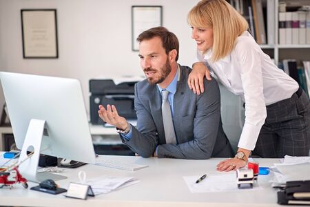 business woman and business man at office working together.