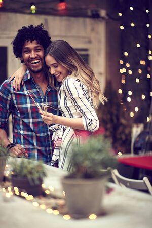 smiling couple  having fun with props on stick in nightclub celebrating. Party, Celebration, love, socializing concept. Zdjęcie Seryjne
