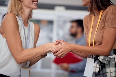 contracted work - handshake business woman at work