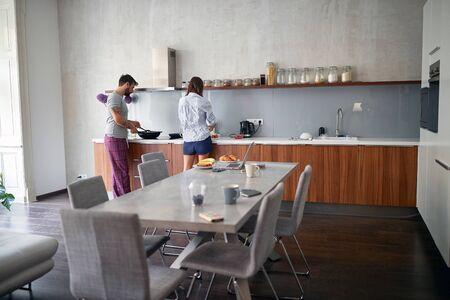 young couple enjoying together in kitchen while preparing food. lifestyle, modern, casual living