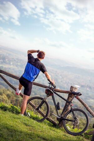 Mountain bike man enjoying in view .Spring, nature ,sport concept