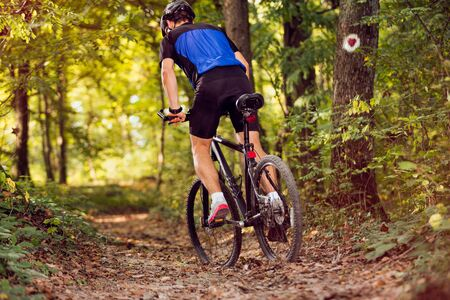 active sporty cyclist riding mountain bike .Spring, nature ,sport concept