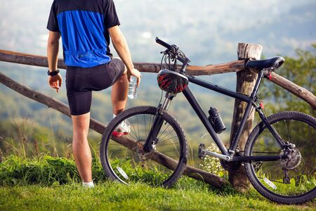 Biker on break enjoy in nature, recreation and relax .Spring, nature ,sport concept