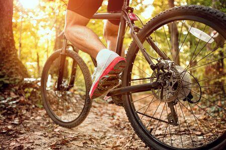 Extreme mountain bike sport athlete man riding outdoors lifestyle trail .Spring, nature ,sport concept
