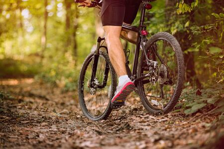 Extreme mountain bike man riding on outdoor trail in forest .Spring, nature ,sport concept