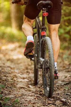 mountain bike man riding on outdoor trail in nature