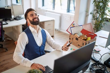 young business male smiling and looking up after he received a good news. men,  modern, office, business concept