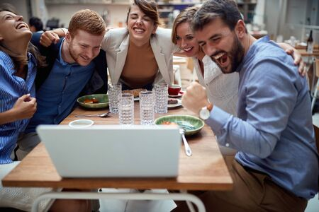 group of young caucasian people having a video call at lunch in restaurant, hugged.  fun, technology, online, internet, friends, business partners, colleagues