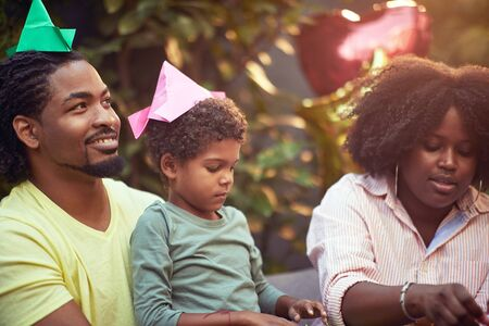 Afro-american family  enjoying and having fun together at home with their children.