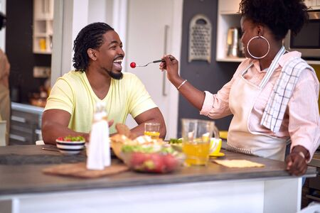 Romantic smiling man and woman eating breakfast at home.Loving couple enjoying in morning.