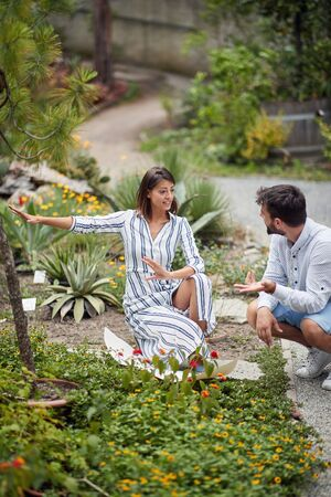 beautiful young sexy female landscape architect explaining new ides to a male colleague about arranging botanical garden Stock Photo
