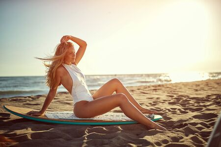 Sexy smiling girl at swimsuit on the beach.Surfer woman. Reklamní fotografie