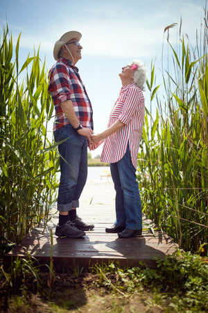 Lovely old couple in love on a sunny day Standard-Bild