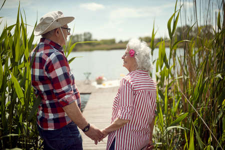 Lovely old couple ready for picnic on a sunny day