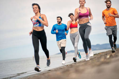 Young People exercise and jogging  for perfect body. Sport and  relaxation on the vacation. Standard-Bild