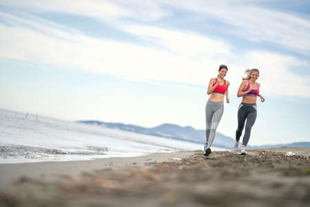 To Be Young exercise. Healthy active Woman  running on beach.