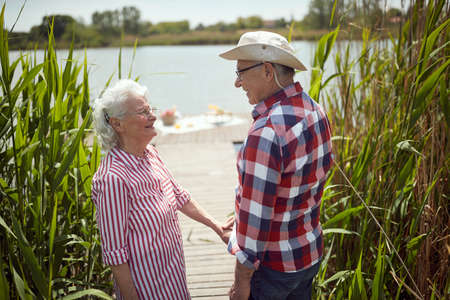 Happy old couple in romantic moments on a sunny day