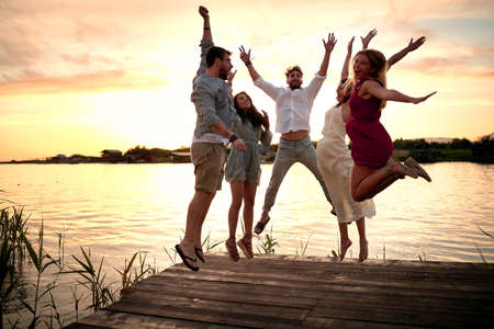 Friends jumping at party.Happy people having fun at  party.