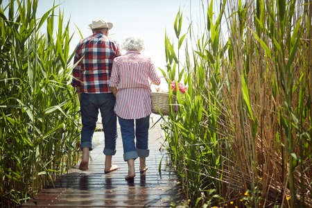 Old couple in love enjoys romantic moments on a sunny day Standard-Bild