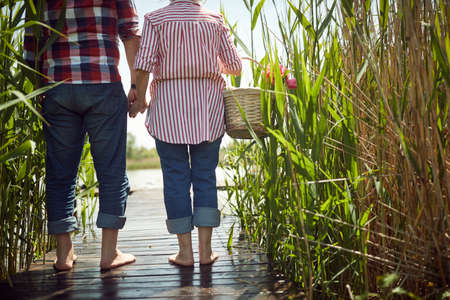 Old couple in love ready for picnic on a beautiful weather
