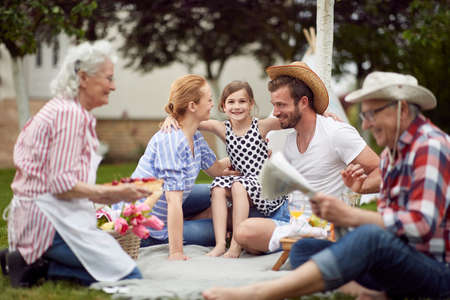 Happy family on picnic on a beautiful day