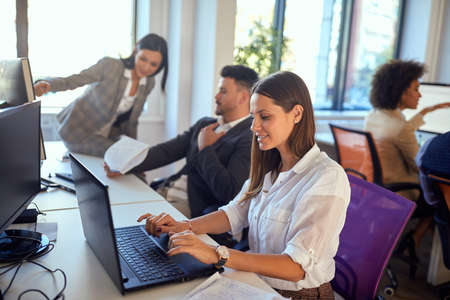 Young woman working in the office on the laptop
