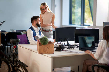 Business people discussion in office. Successful male and female working together.