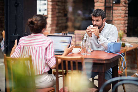 Young couple having heavy discussion at a cafe
