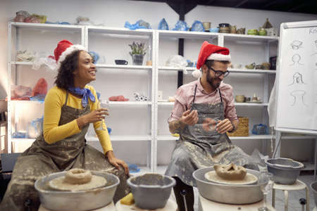 Friends having casual festive themed pottery class together; Casual Christmas or New Year celebration