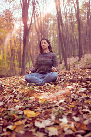 Woman meditationg in forest, Connected with Nature, Breathing practice, Peace and Freedom concept