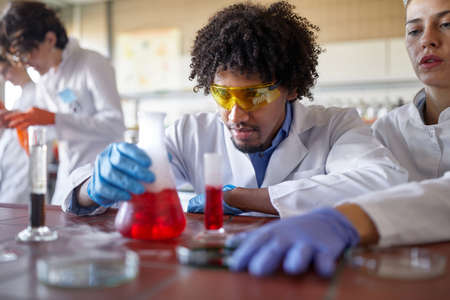 Medical students conducting chemical experiment in the lab