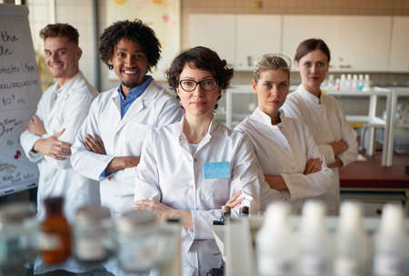 Group of young laboratory technicians in the lab Standard-Bild
