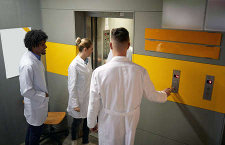 Group of young medical interns entering the elevator