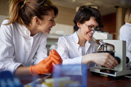 Two female laborant researchers preparing samples for analysis