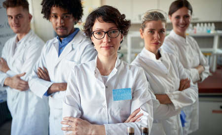 Team of young medical laboratory technicians in the lab Standard-Bild