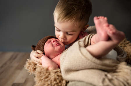 Little boy kissing his little crying brother, and comforted him Standard-Bild