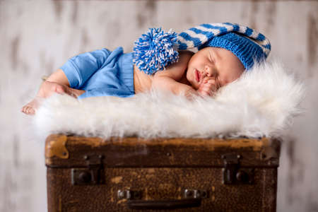 Sleeping newborn baby on softy white blanket