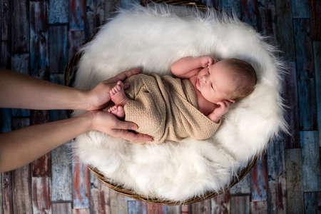 Little newborn baby enjoys the attention of her mother Standard-Bild