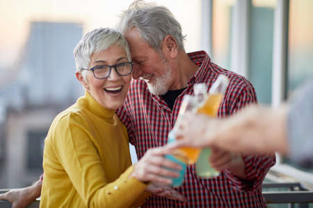 An older couple drinking and celebrating together