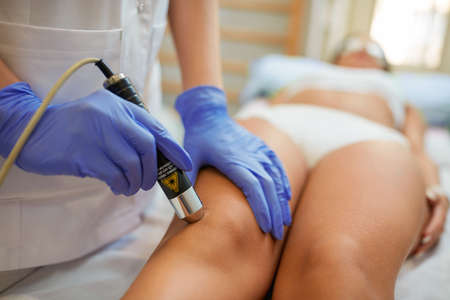 physical therapy at spa clinic healing jumper's knee