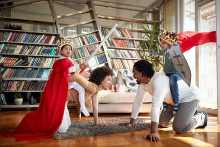 Happy afro american family playing together at home