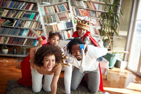 Lovely afro american family playing together at home