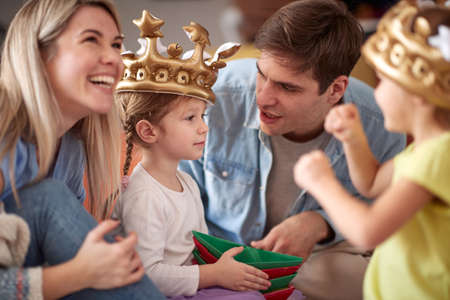 Young family having wonderful time in a cheerful atmosphere at home together. Family, playing, home, togetherness