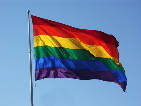 Big Rainbow Flag in Blue Sky Stock Photo