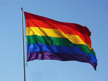 pride: Big Rainbow Flag in Blue Sky Stock Photo