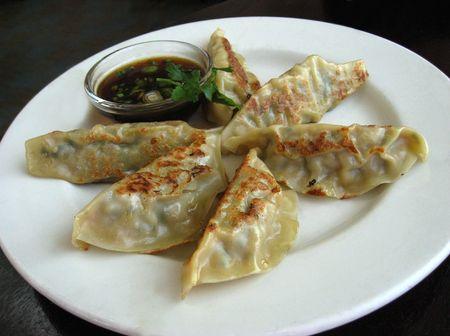 potstickers: Plate of potstickers in restaurant